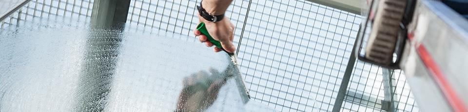 Squeegee glass cleaning